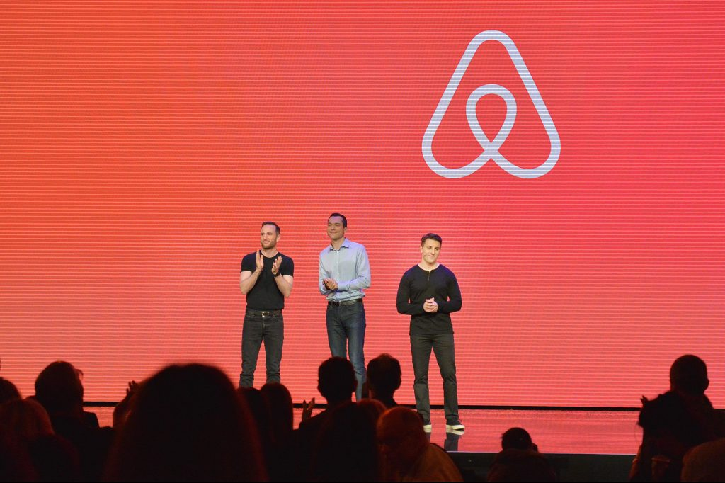 "LOS ANGELES, CA - NOVEMBER 17: (L-R) Airbnb Founders CTO Nathan Blecharczyk, Chief Product Officer Joe Gebbia and CEO Brian Chesky speak onstage during the ""Introducing Trips"" Reveal at Airbnb Open LA on November 17, 2016 in Los Angeles, California. (Photo by Charley Gallay/Getty Images for Airbnb)"