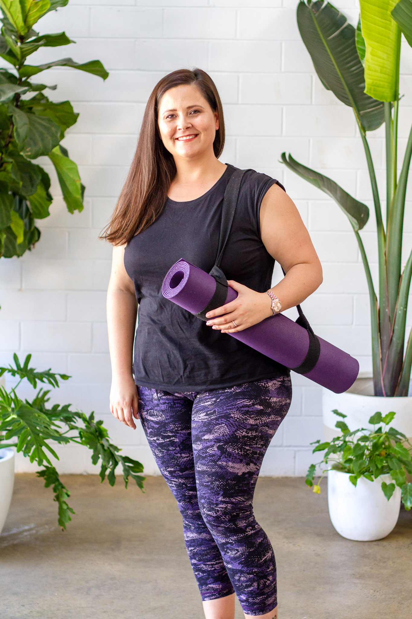 personal brand photo of girl and yoga mat surrounded by plants