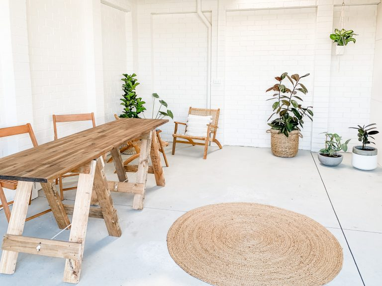 bright white studio space with wooden furniture and plants